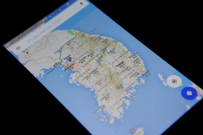 A photo illustration shows Google Maps application displayed on a smartphone in Seoul